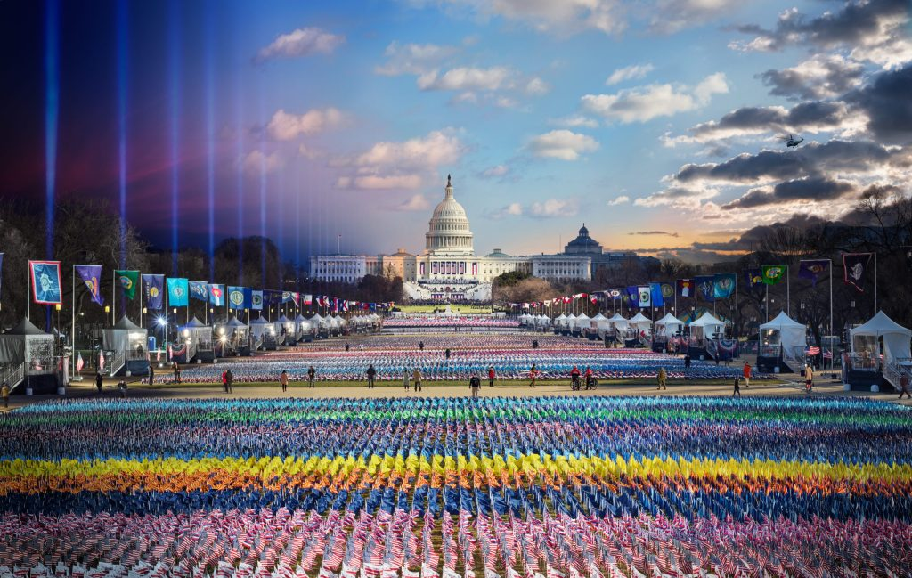 Stephen Wilkes and his assistant Len Christopher (supported by a team of security and logistics experts) stood on a 40-foot crane in nonstop 35mph winds for more than 12 hours, shooting the images to create this magnificent photo of the 2021 Inauguration. The time scale of the photo moves from right to left, from day to night. In the top right-hand corner, Marine One flies away; at center, a sea of hundreds of thousands of flags represent those lost to Covid in 2020; at right, the evening lights. This photo premiered in National Geographic.
