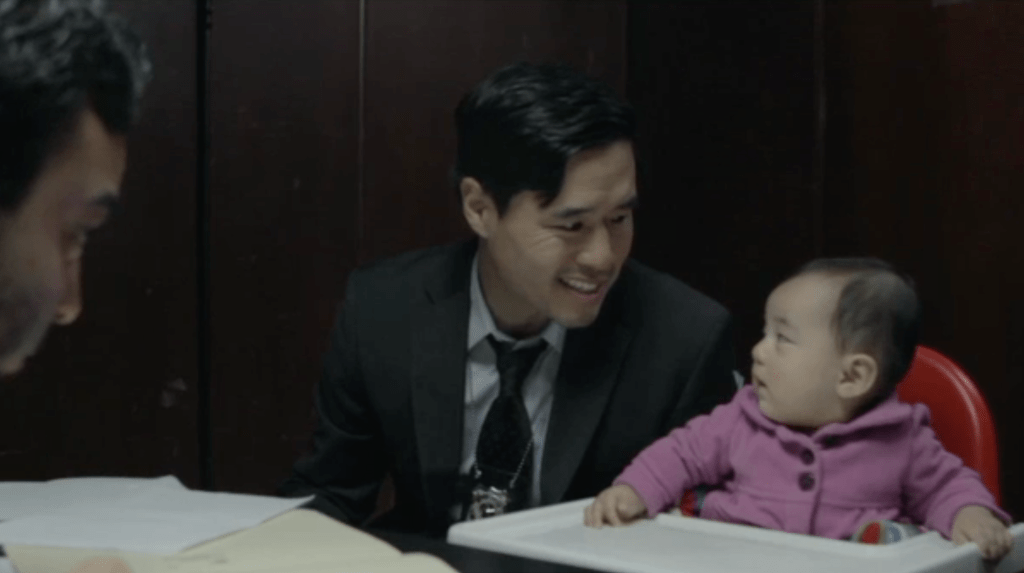 Randall Park and baby Ruby as a pair of hardboiled detectives, in Baby Mentalist.