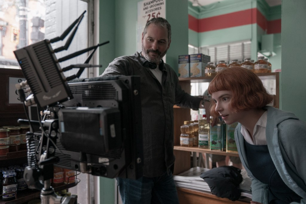 Director, writer and executive producer Scott Frank (here with Anya Taylor-Joy as Beth) was key to bringing the project to Netflix, where the two-hour movie could be re-imagined as a six-episode miniseries — unlocking the book's dramatic potential. Photo: Ken Woroner/Netflix © 2020