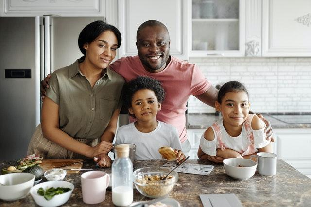 Smiling family saving in VA 529 Tuition Track