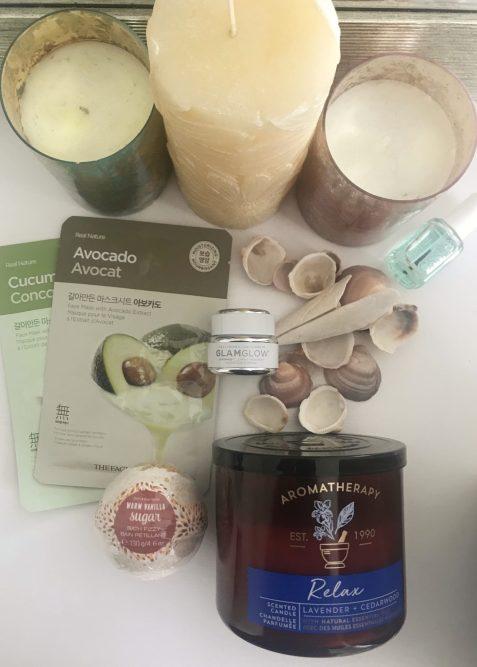 3 candles, sea shells, face masks, bath bombs, and clear nail polish