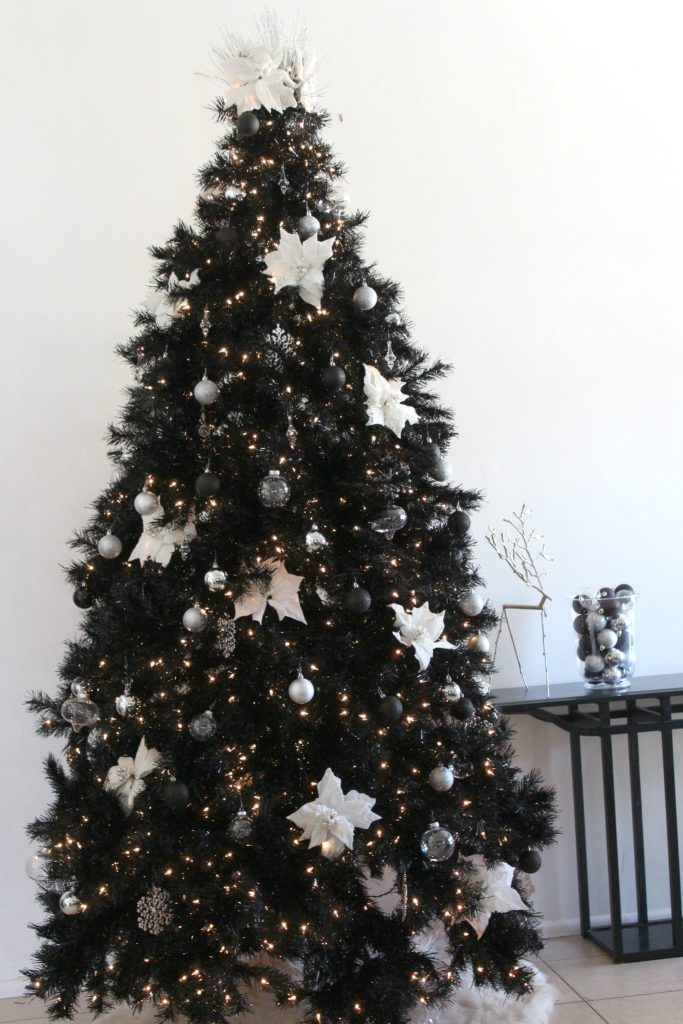 Tall, dark and handsome! This Tuxedo Black Christmas trees is classy and gorgeous!