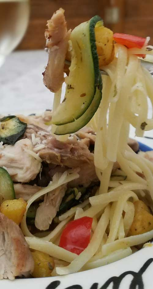 Flavorful pan roasted squash, zucchini, and red bell peppers come together on a bed of linguine, with a simple ricotta and parm cream sauce makes this a winner winner chicken dinner.