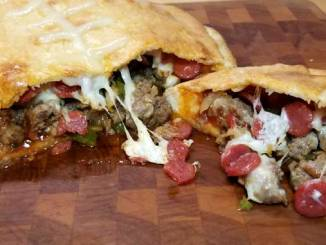 This Meat Lovers Gameday Calzone has all the fixings of a cheesy supreme pizza in a Football Calzone form. Fun to make and even more fun to eat! Perfect for a Super Bowl party or any gameday!