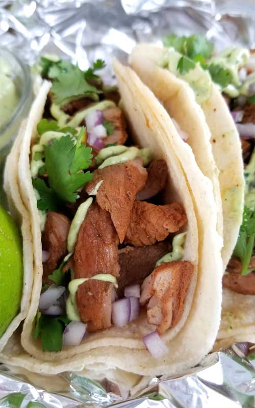 Carne Adovada Street Tacos Recipe - Looks like a misspelling of Avocado, it's not. This is what it's called, and it's the most tender, moist and flavorful Pork Tacos we've ever had! We also made an awesome Creamy Avocado Cilantro Lime Dressing to top it off with.