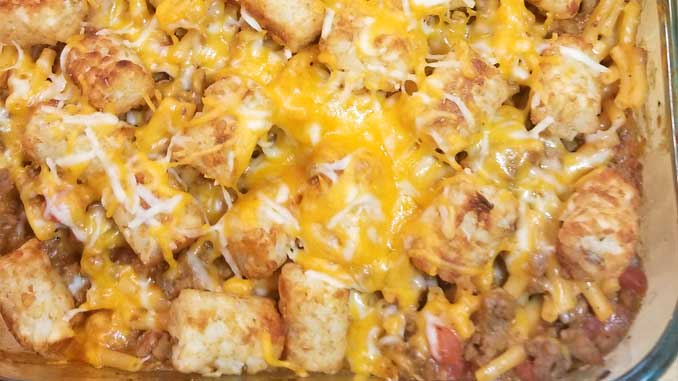 Mac n Cheesy Cowboy Casserole Recipe - Meaty, Mac n Cheesy, tater tot goodness topped with even more cheese. What is not to love about this?