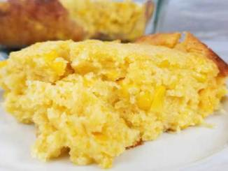"Somebody call Oprah, she would definitely put this on her ""New Favorite Things List"". It is so good and with such simple ingredients, it's hard to believe not everyone knows about the buttery,cheesy goodness that is this Sweet Creamed Corn Casserole"
