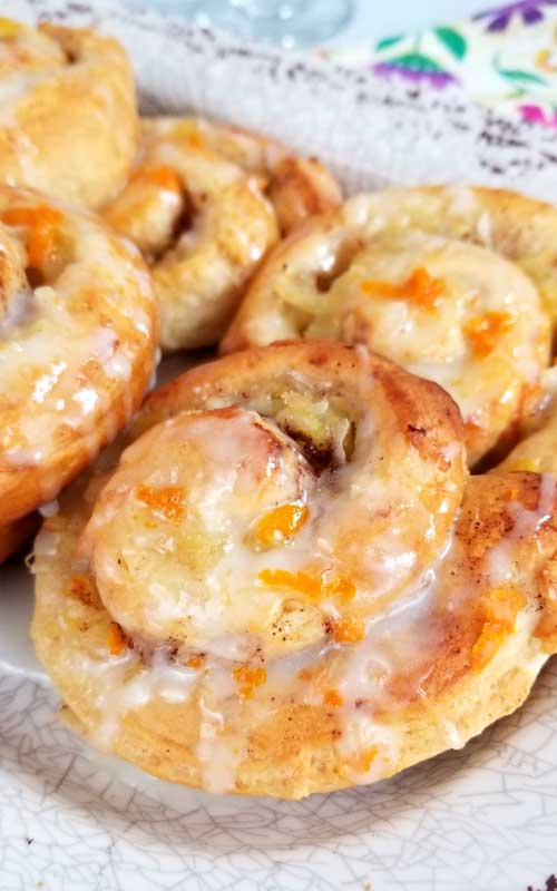 Jazz up your morning with some sweetness. Quick and simple Orange Pineapple Sweet Rolls with a Pineapple Glaze!