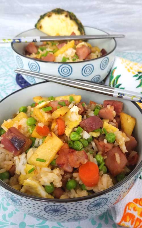 This Pineapple Fried Rice brightened our day with yummy sweet pineapple, salty ham, and all of the fresh veggies coming together to be downright deliciousness!