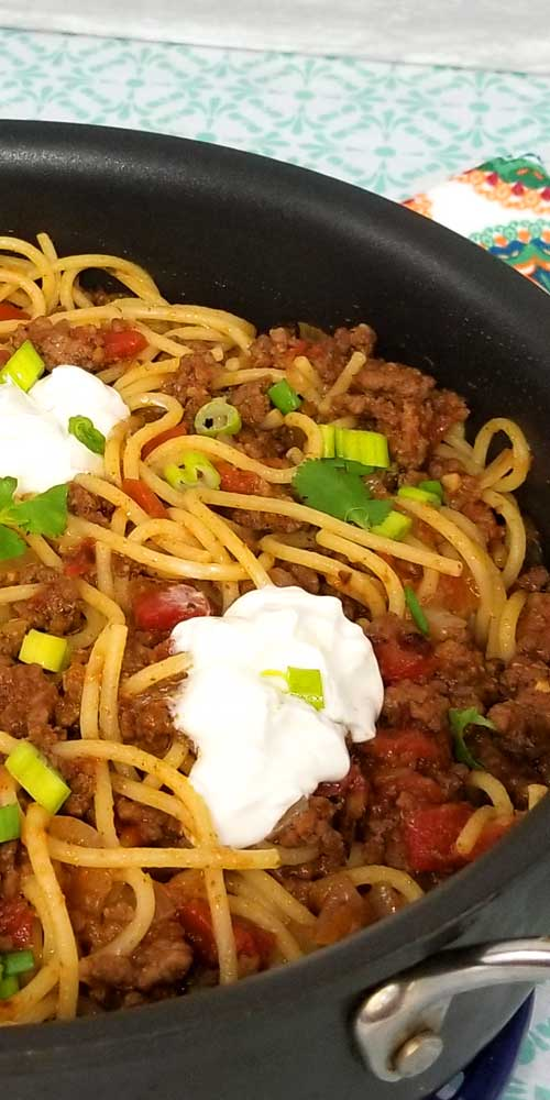 Taco Spaghetti Recipe - Quick easy and full of flavor, that's what I like for a busy weeknight dinner, and this Taco Spaghetti recipe comes together in under 30 minutes. the perfect no fuss, quick clean up dinner.