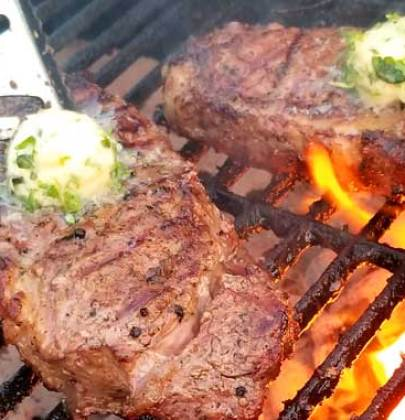 Grilled Rib-Eye Steaks with Roasted Garlic Herb Butter
