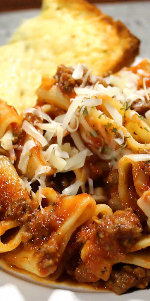 This homemade Italian Pasta and Marinara Meat Saucewill make you feel like you're pulling up a chair with generations of the great little old Italian ladies.