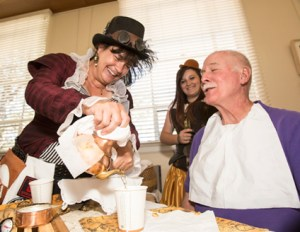 "John Byrne photos/Tribune -  The Sparks Heritage Museum hosted a ""Building Steam"" fundraiser on Saturday to raise money for its endowment fund. (Above) Lisa Fisher serves tea during one of the events."