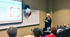 "Kayla Anderson -  Vicki Kawelmacher speaks at the initial ""Help Me Help Her"" women's self defense class at Scheels on Sunday."