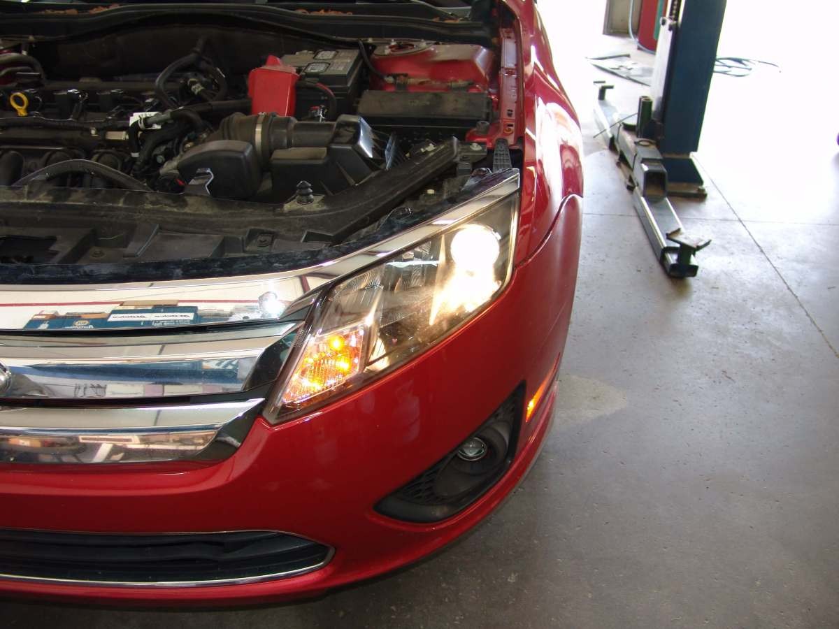 This 2012 ford fusion came in with the complaint that the driver s side low beam headlight id not work the customer stated that she had the bulb changed a