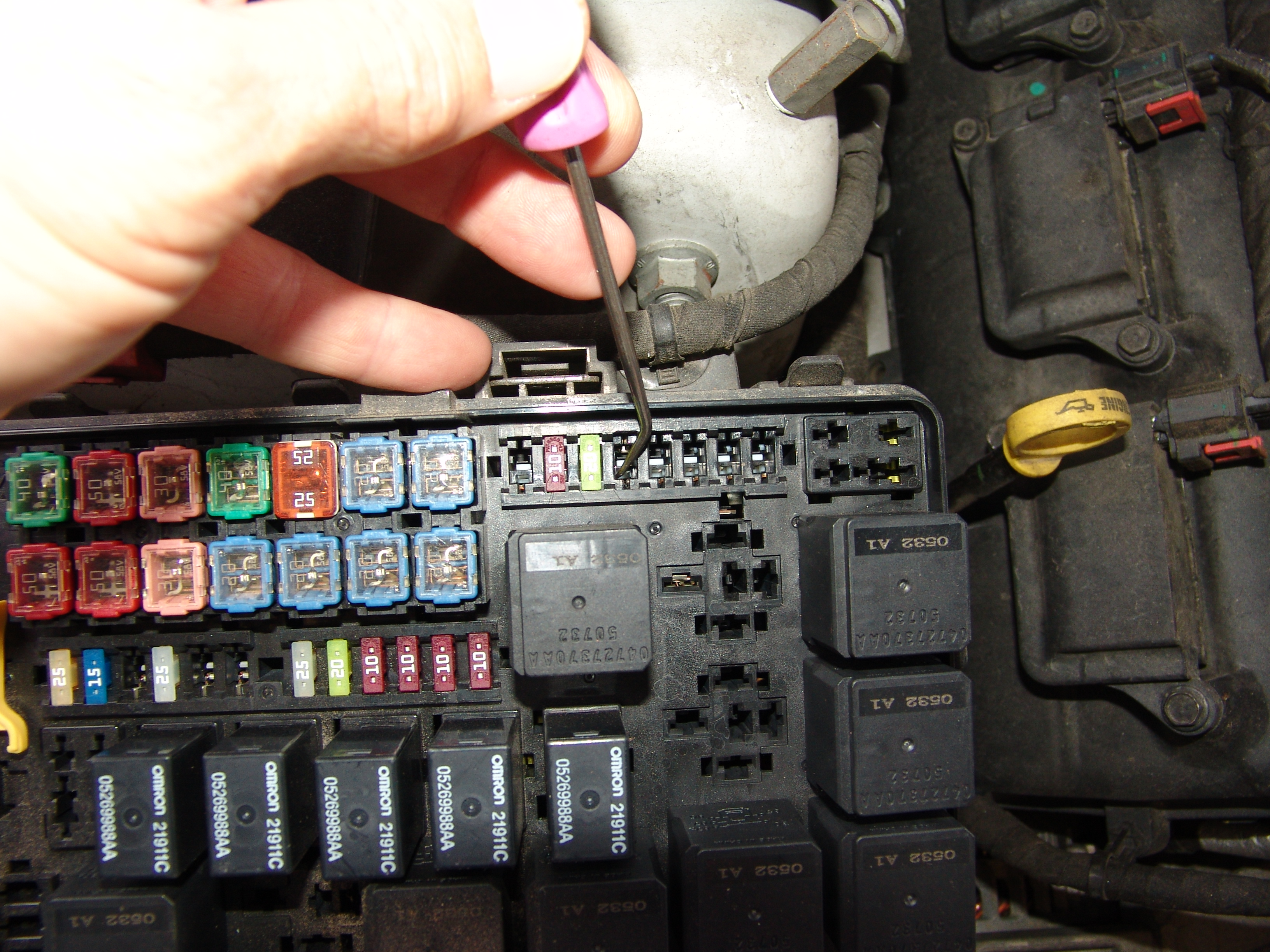 I also installed a new fuse. The best way to fix this is to install a new fuse  box assembly but the customer did not want to go that deep into this repair.