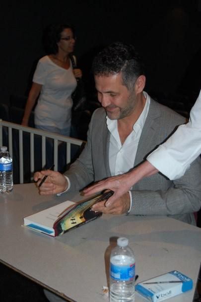 Khaled Housseini signing books at Bourgade High School. Photo by Anja Asato