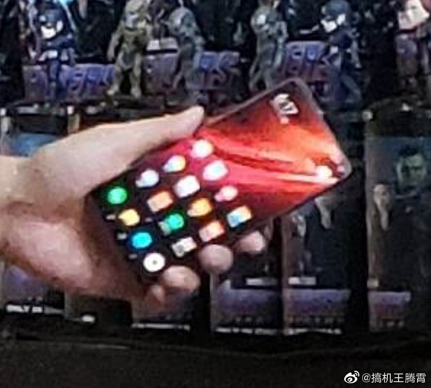 Lu Weibing holding Un-Released Redmi phone
