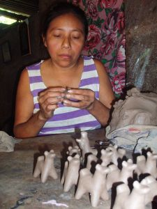 Esperanza artisan hand-sculpts small clay llamas. With the help of Esperanza, these handcrafts are exported to fair trade shops throughout North America.