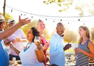 Group of diverse people drinking wine and spend time together