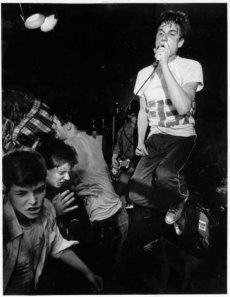 Slam Whitman's Jeff Burnett takes flight amid a punk rock mosh pit. Photo from Slam Whitman's Facebook Page