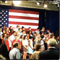 The adorable students on the risers behind where Obama would speak. The stood for HOURS there.