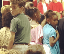 These young children were waiting impatiently for Obama. All are standing up on chairs so they can see.