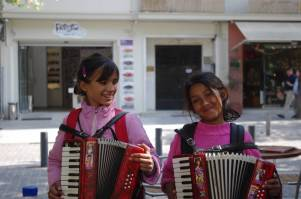 """Young girls singing """"Never on Sunday"""" in Athens, Greece."""