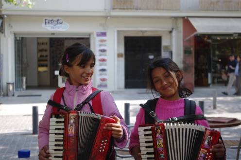 "Young girls singing ""Never on Sunday"" in Athens, Greece."