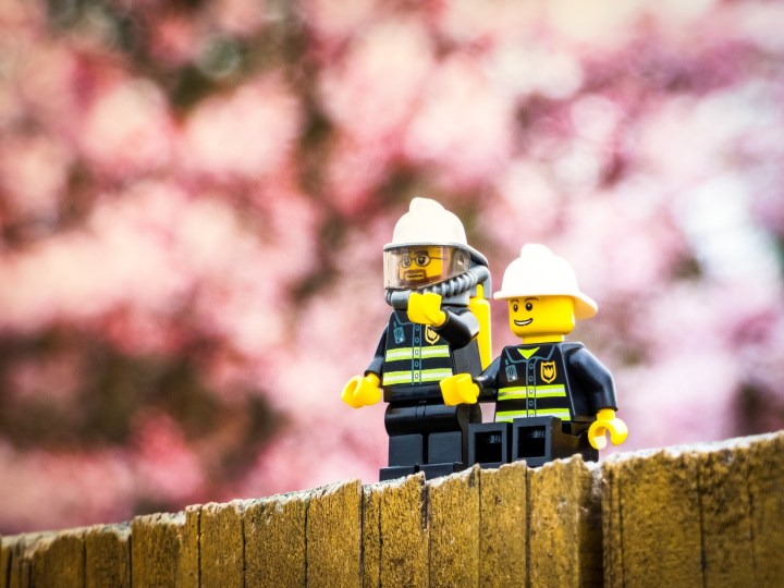Lego firefighters on a wall.