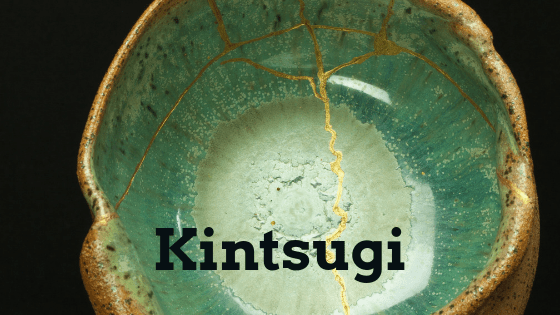 A pot that has been repaired through the Kintsugi method showing veins of gold.