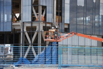 workers place the glass walls on the new Sheridan City Centre campus.