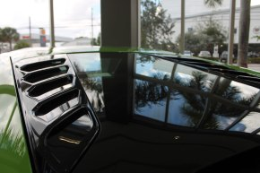 The view from the windows reflected upon the Lamborghini.