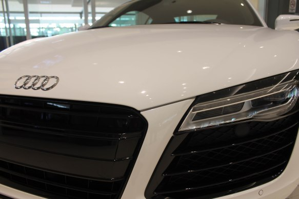 The contrast and color block of the Audi makes it appear to have an abstract face.