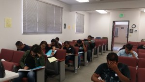 Prospective interpreters doing a mock exam of the written portion of the California Court Interpreter test.