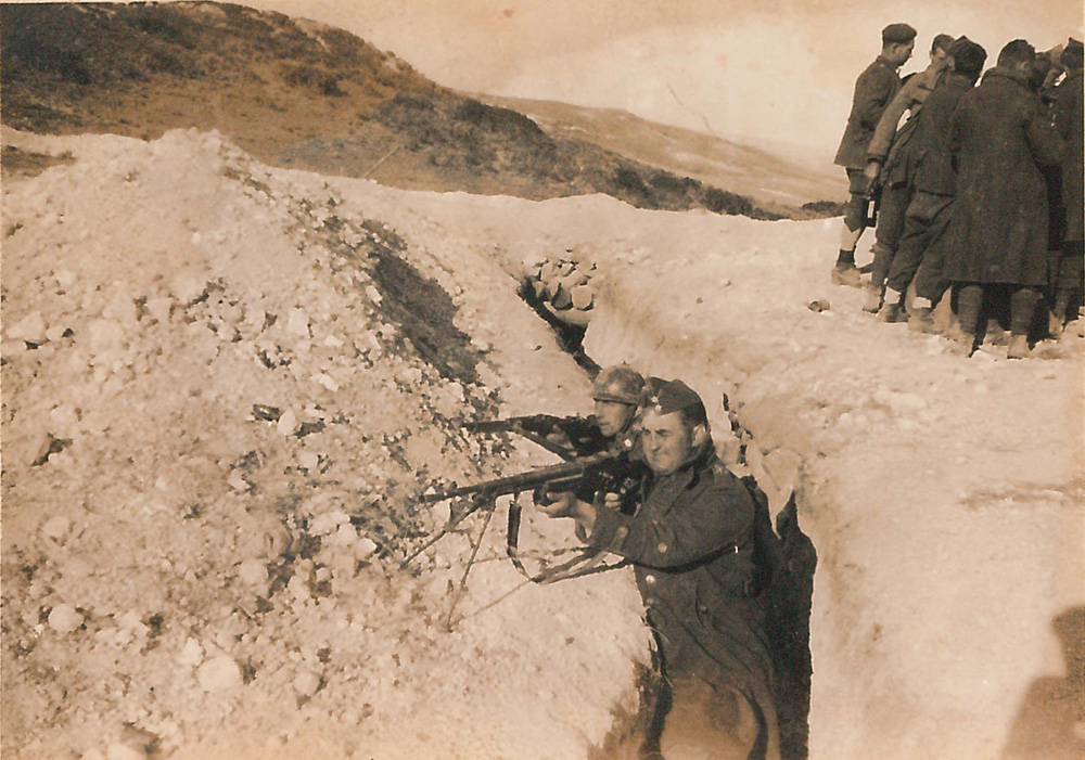 black-and-white picture of Michael Weymes and another man in military uniforms, holding guns in a trench