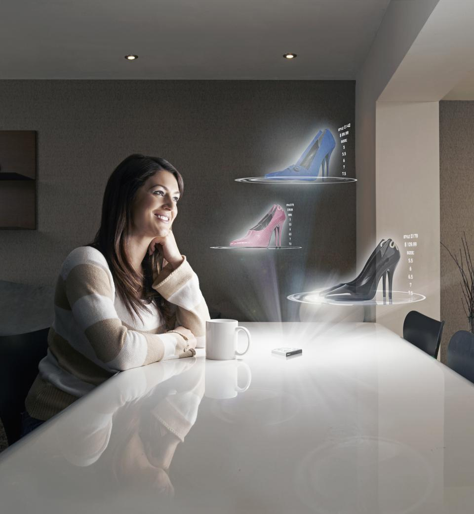 Woman shopping online on futuristic 3D device