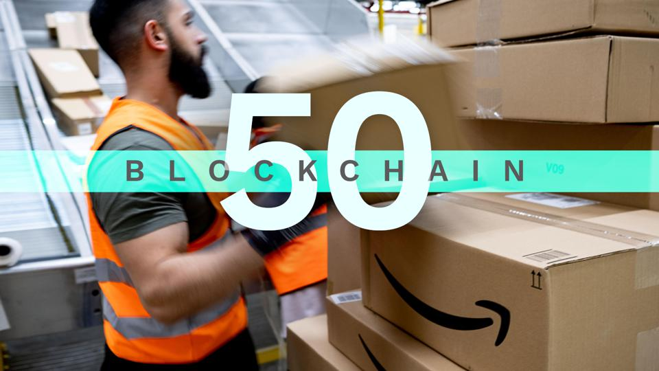 An employee of Blockchain 50 list member Amazon loads boxes.