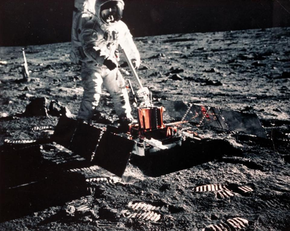 Buzz Aldrin deploying the Passive Seismic Experiments Package (PSEP) on the lunar surface.