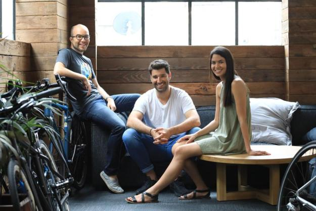Canva cofounder Cameron Adams (left), with cofounders Melanie Perkins and Cliff Obrecht.
