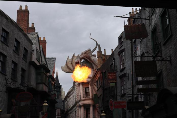 An escaped dragon sits atop Harry Potter and the Escape from Gringotts