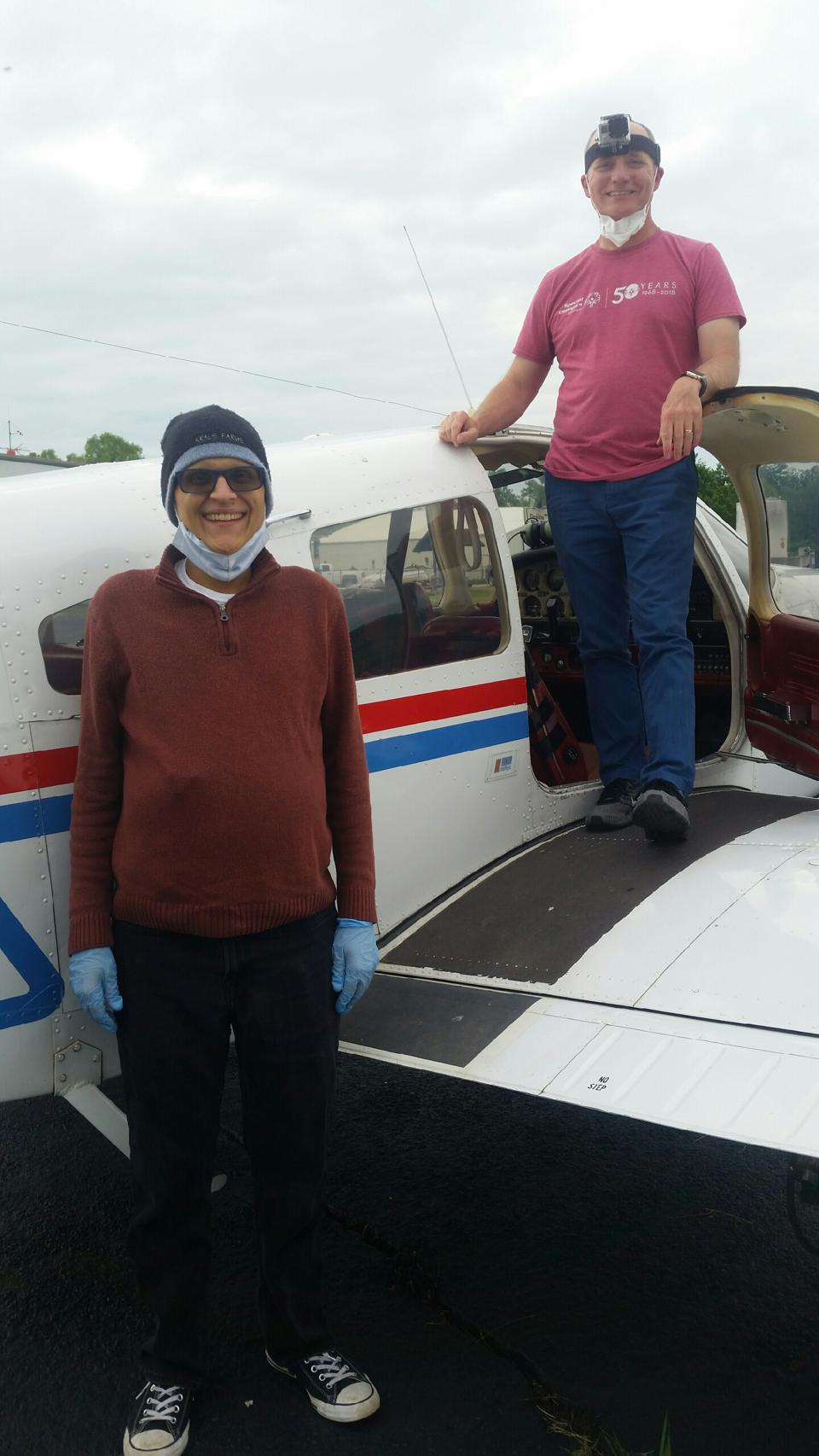 Rudy Torrini and friend Alan Kirby standing next to a Piper Cherokee at Festus Airport, MO