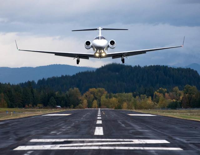 A Cessna CitationJet with Tamarack ATLAS winglets climbs off the runway.