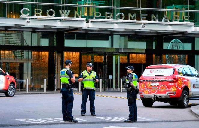 Police stand guard outside Crown Promenade hotel Melbourne Australia used for quarantine