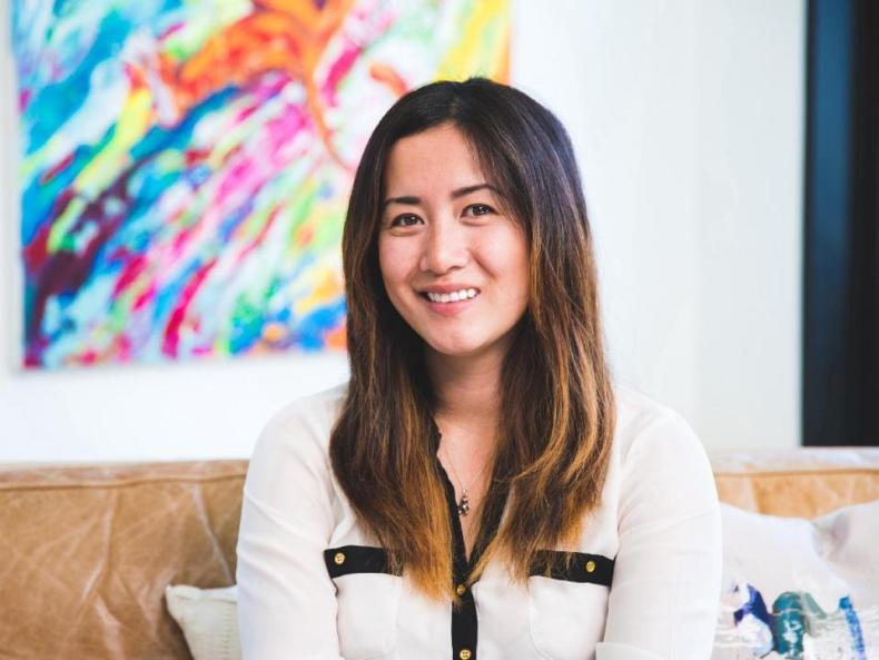 Image of Jessica Chang, WeeCare CEO & Founder sitting and smiling.