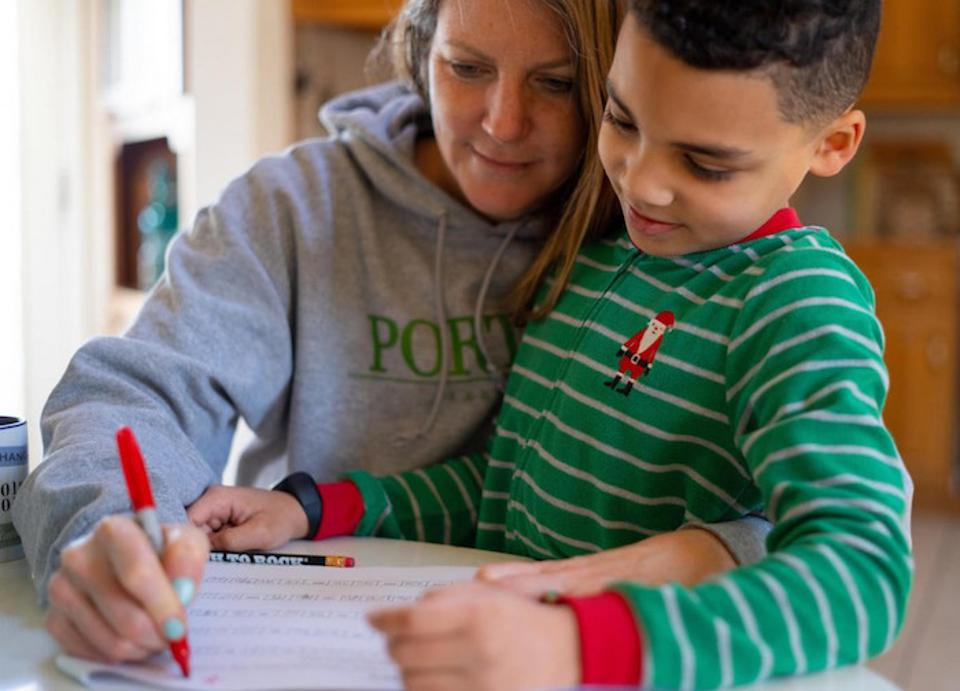 On the morning of March 16, 2020, during the COVID-19 lockdown, 8-year-old second grader Luka works on a math assignment at home in Connecticut, with help from his mother, Sophia.