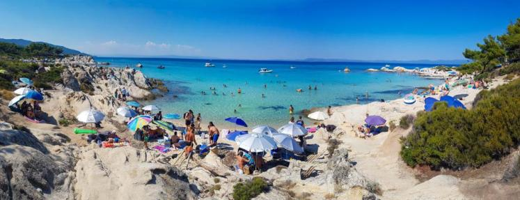 Tourism In Greece amid Covid people on beach