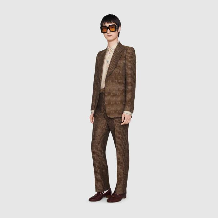 Gucci:Brown Suit: Diagonal GG stripe cotton silk jacket, GG stripe wool silk tailored pant, Gucci pinstripe cotton shirt with crystals