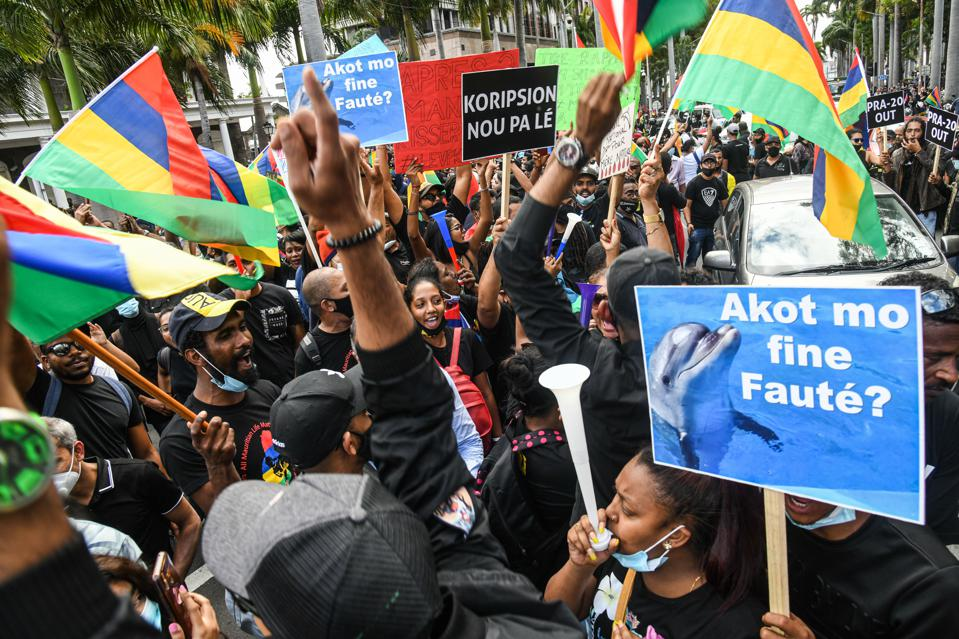 There has been large social protests in Mauritius to protest at how the oil spill response has been handled (seen here wearing black to symbolize the spilt oil)