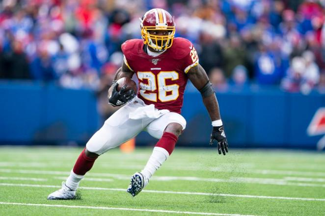 Washington Redskins Running Back Adrian Peterson (26) runs with the ball during the first half of the National Football League game between the Washington Redskins and the Buffalo Bills on November 3, 2019, at New Era Field in Orchard Park, NY.